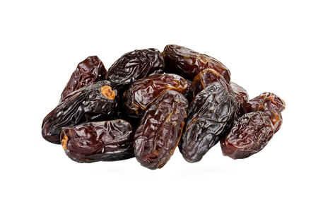 Dried Medjool Dates over a white background with clipping path.