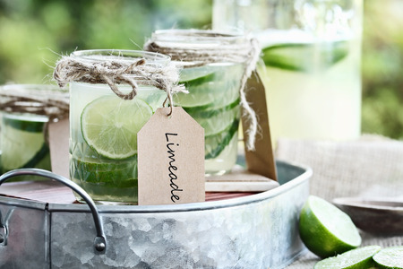 jars: Limeade in mason jars with extreme shallow depth of field. Stock Photo
