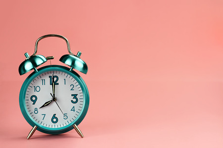 down beat: Vintage style alarm clock with copy space for text. Stock Photo