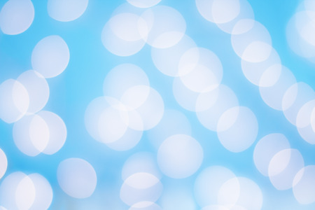 Bright sparkly abstract background of blue Christmas holiday bokeh lights.
