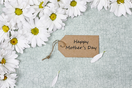 Mothers Day card and daisies shot from above.