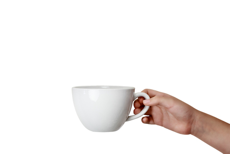 Isolated woman's hand holding coffee cup over white background with room for copy space. photo