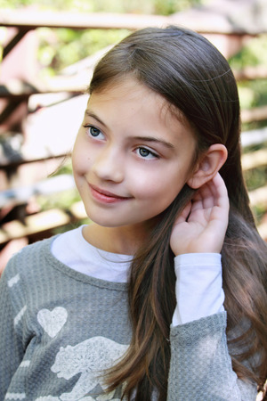 Young pre-teen kid with long hair. photo