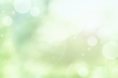 Bright abstract background of blurred circular green bokeh circles for summer backgrounds. Stock Photo - 81102019