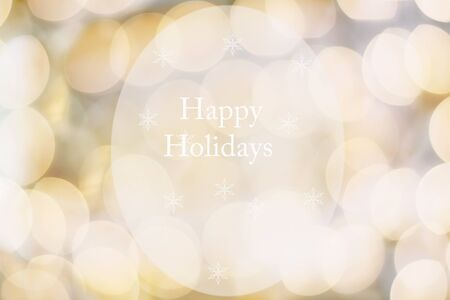 Abstract text message of Happy Holidays against a golden blur bokeh background or banner. Stock Photo