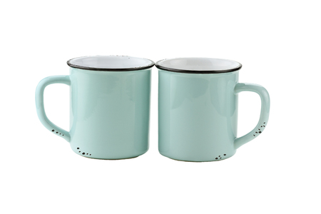 Two teal colored enamel coffee cups or mugs with copy space for logo isolated over a white background with clipping path included.