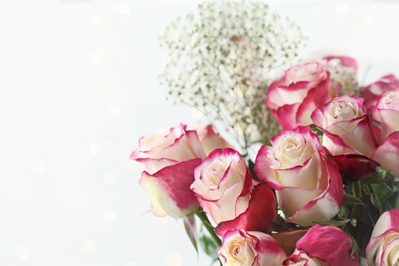 Beautiful bouquet of  red and white roses with babys breath. Selective focus with shallow depth of field.