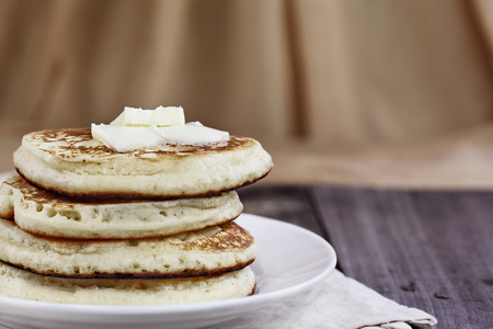 Stack of homemade pancakes with melting butter. Extreme shallow depth of field. Perfect for Shrove Tuesday. Stock Photo