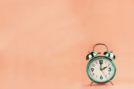 Colorful vintage style alarm clock with room for free background space for text. Imagens - 105601802