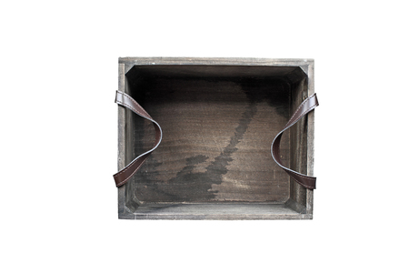Old wooden box with leather straps isolated over white background with clipping path included. Image shot from above.