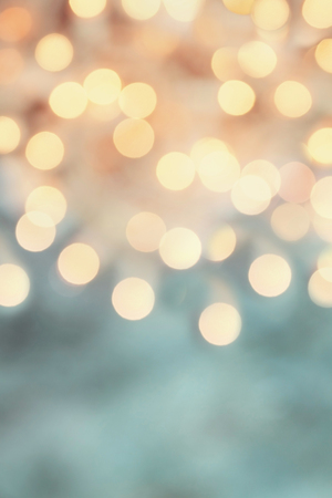 Abstract background of retro tinted holiday bokeh lights with free space for text. Stock Photo