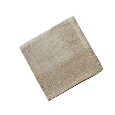 Square linen napkin isolated over a white background with clipping path included. Image shot from overhead. Stock Photo