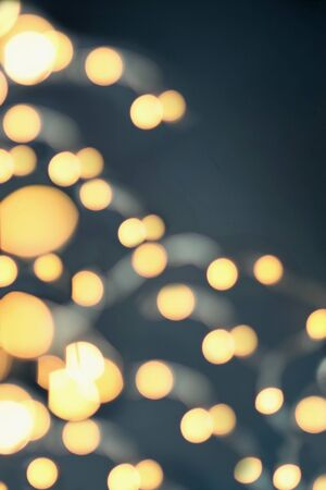 Abstract of blurred string of gold Christmas lights to use as texture or background. 版權商用圖片