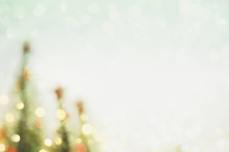Abstract photo of a blurred Christmas tree background with bokeh and copy space.