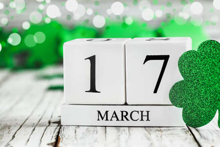 Happy St Patrick's day. White wood calendar blocks with the date March 17th. Selective focus with blurred background.