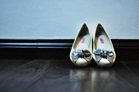 Ballerina Flats on wooden floor Stock Photo