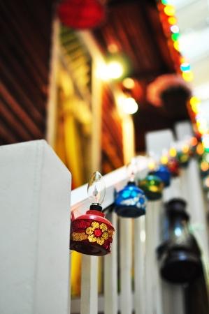 malay village: Vel�n colorido que cuelga en la escalera Foto de archivo