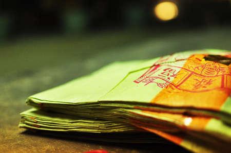 Yellow Joss Paper Money In Buddhist Temple