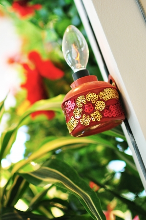 kampung: Red Oil Lamp On Pillar Stock Photo