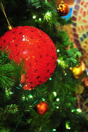 Big Red Ornament Shining on Christmas Tree Stock Photo - 16841850