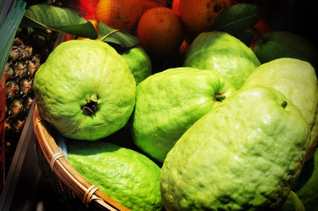 Guava in a basket for sale Stock Photo