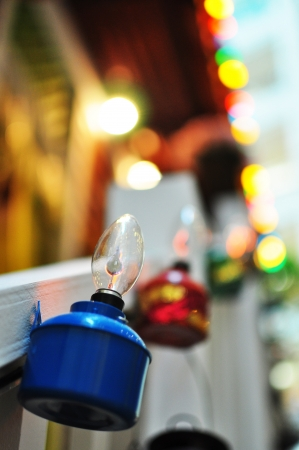 malay village: Blue Oil Lamp Hanging on Village House Stock Photo