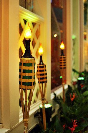 malay village: a row of tea lamp litted at malay wooden house Stock Photo