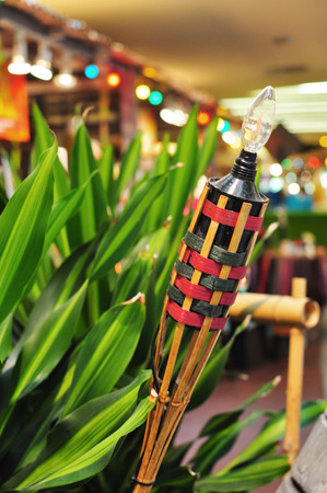 malay village: Pelita with bokeh in background Stock Photo