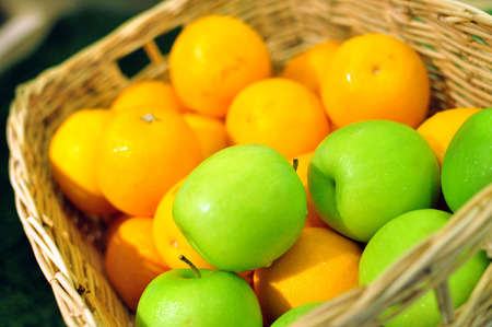 quencher: Apples and oranges in basket for sale