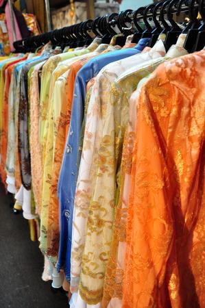 malay village: Baju Kurung for sale in the shopping mall Stock Photo