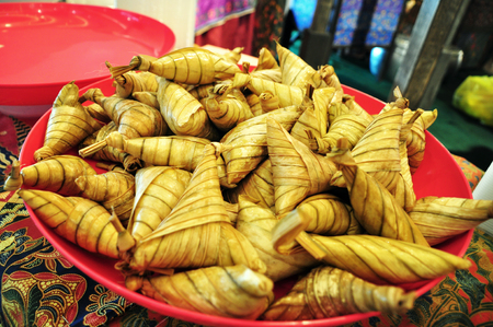 compressed rice: Ketupat Palas in a plate ready to be served for buka puasa dinner