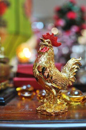 Golden Rooster with red comb and ingots for sale