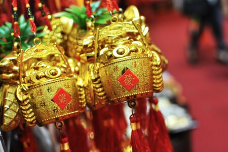 a bunch of gold bucket filled with ingots, chinese text translation : prosperity