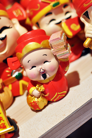 Chinese Deity God Of Wealth holding greetings text translate to Wealth Stock Photo