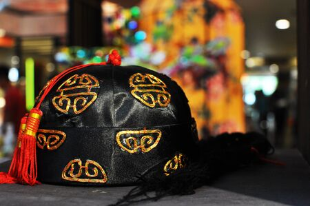 Chinese Traditional costume flat hat on table