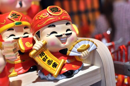 Chinese Deity God Of Wealth holding greetings text translate to Usher Wealth Luck
