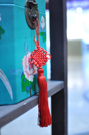 Mystic Knot Red String Hanging on a box
