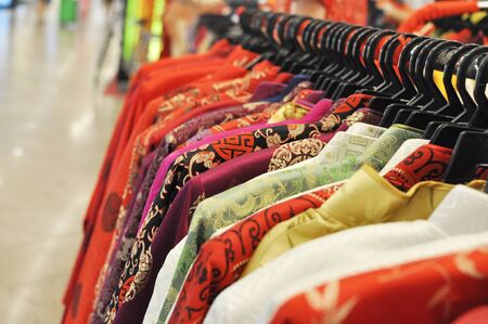 Chinese Traditional Mens Wear hanging in a row Stock Photo
