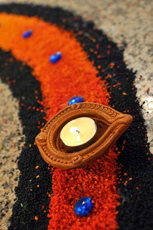 Hindu Deepavali Oil lamp placed on colorful kolam Stock Photo