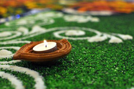 Hindu Deepavali Oil lamp placed Green kolam
