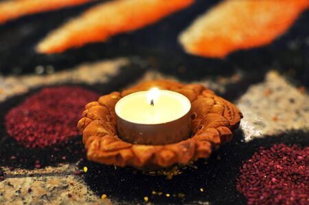 Hindu Deepavali Lit Oil lamp placed kolam, floor art Stock Photo
