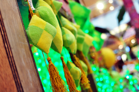 Close Up Ketupat Decoration hanging on kampung house during hari raya Stock Photo