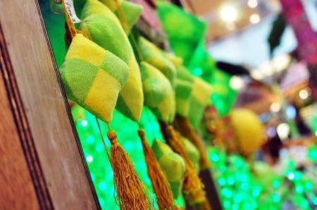 kampung: Close Up Ketupat Decoration hanging on kampung house during hari raya Stock Photo