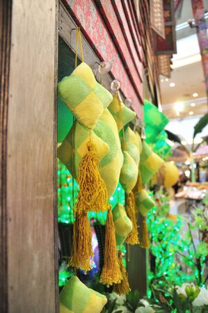 compressed rice: Ketupat Ornaments Decorated on a village wooden house during Hari Raya