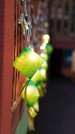 compressed rice: A row of Ketupat Lightings on Display for Hari Raya with Bokeh Stock Photo