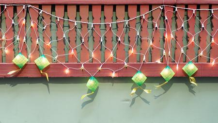 compressed rice: A row of green Ketupat Decorative Lightings for Hari Raya