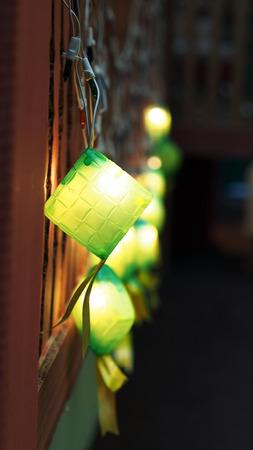 compressed rice: Close-up Green ketupat decorative lightings for Eik Mubarak Hari Raya Stock Photo