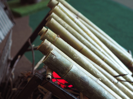 Cooking lemang in bamboo at the fire