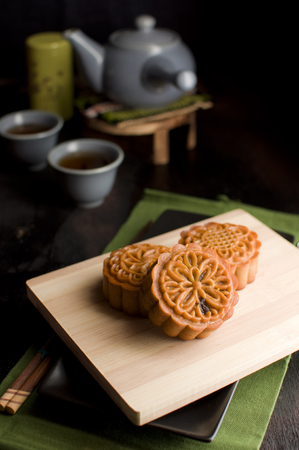 black and green theme traditional mix nuts homemade mooncakes serve with chinese tea
