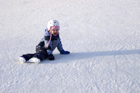 rideau canal: A Young Skater sitting on ice